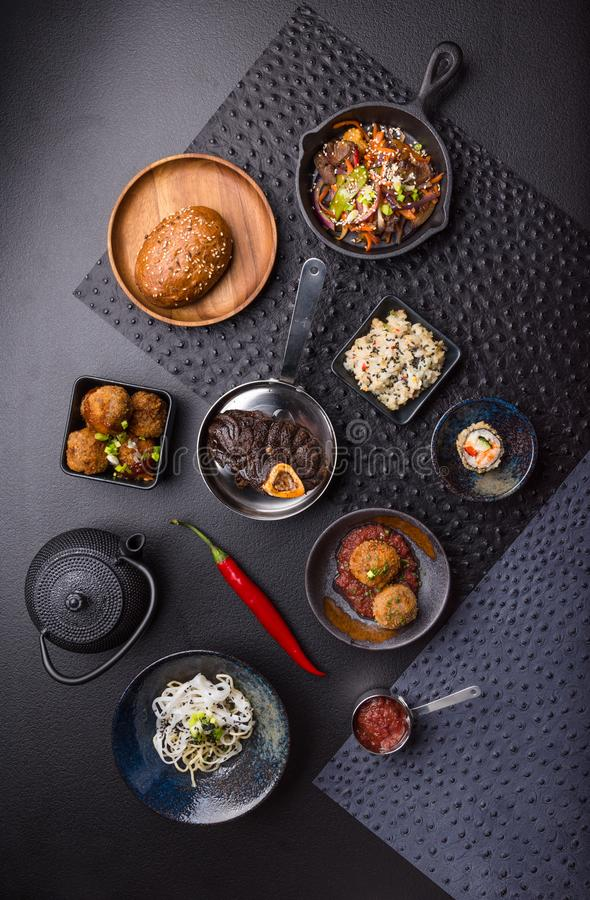 Asian food top view setting, black background royalty free stock image