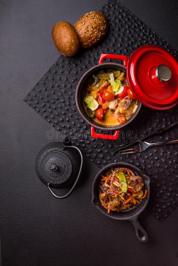 Spicy food vegtable stew top view setting, black background royalty free stock photography