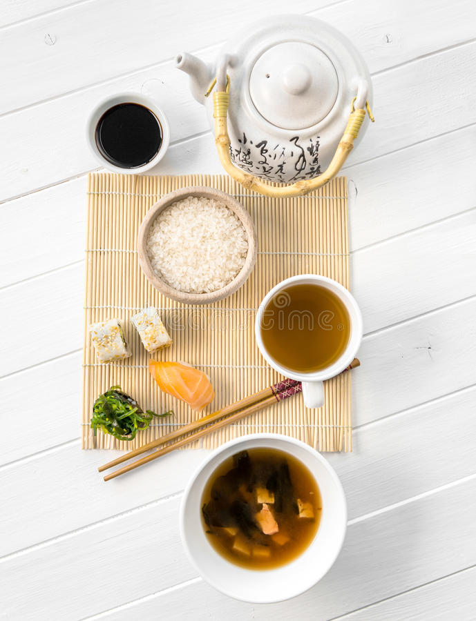 Asian food, rice and raw fish, topview. Asian food, rice and raw fish, soy sauce and some mushroom soup, topview royalty free stock photo