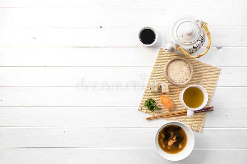 Asian food, rice and raw fish, topview. Asian food, rice and raw fish, soy sauce and some mushroom soup, topview. space for text left stock images