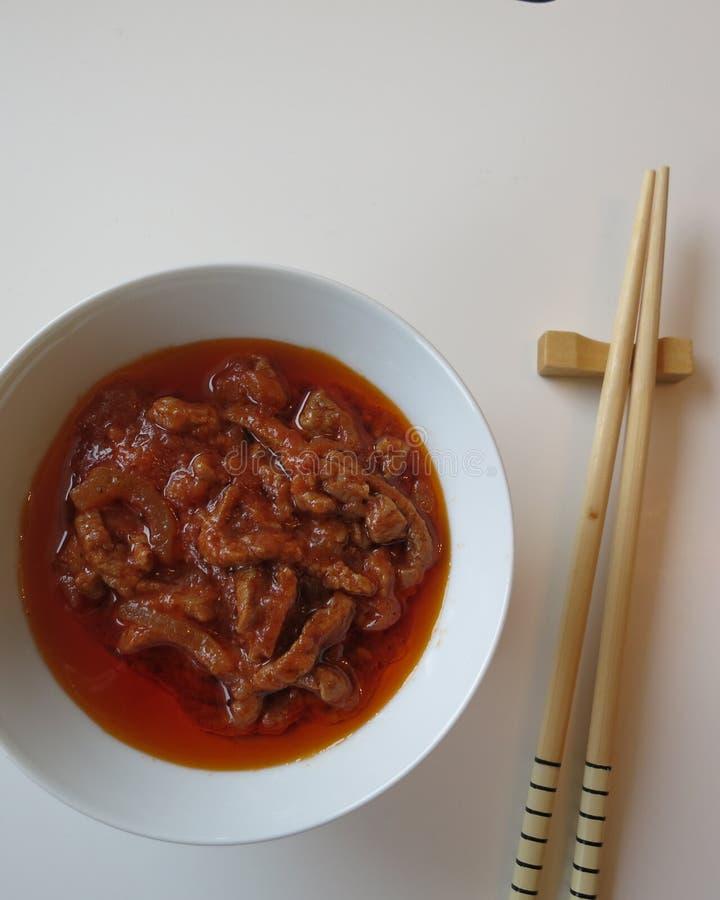 Asian food. Steak cut in strips,crush tomato,onion,garlic,black pepper and salt royalty free stock photo