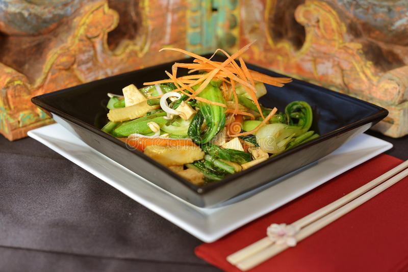 Asian food in stir fry wok royalty free stock photography