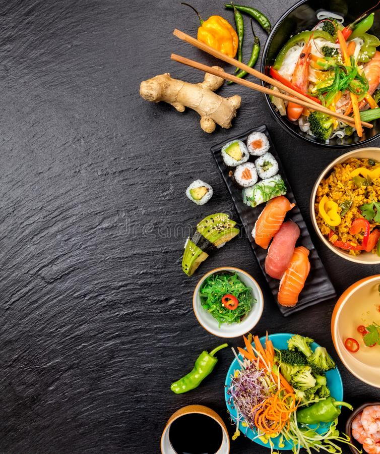 Asian food variation with many kinds of meals and sushi royalty free stock photo