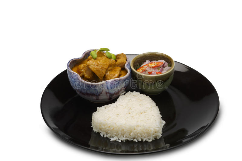 Asian food. Yellow Curry Chicken in Coconut Milk With Rice on on isolated white background. Chicken curry stock photos