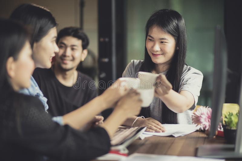 Asian freelance relaxing lifestyle in home office stock photos