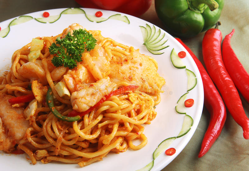Asian fried noodle. Asian spicy seafood fried noodle royalty free stock photos