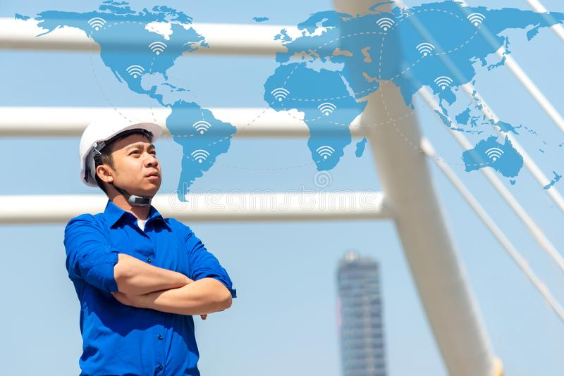 Asian futuristic architect engineer with network and wireless communication  connection in construction site stock photo