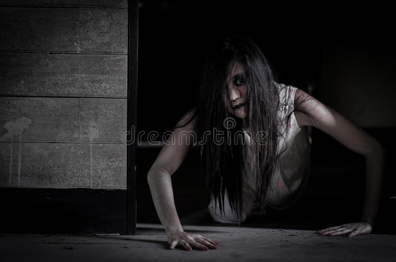 Asian Ghost story girl in haunted house royalty free stock photo