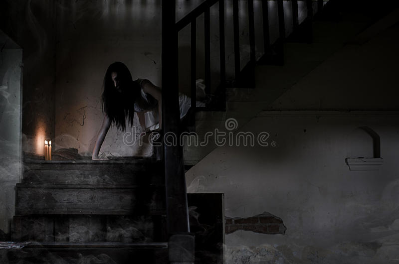 Asian Ghost story girl in haunted house. The Asian Ghost story girl in haunted house royalty free stock images