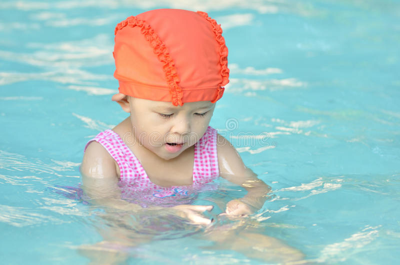 Asian girl. Cute small asian girl with swim suit stock images