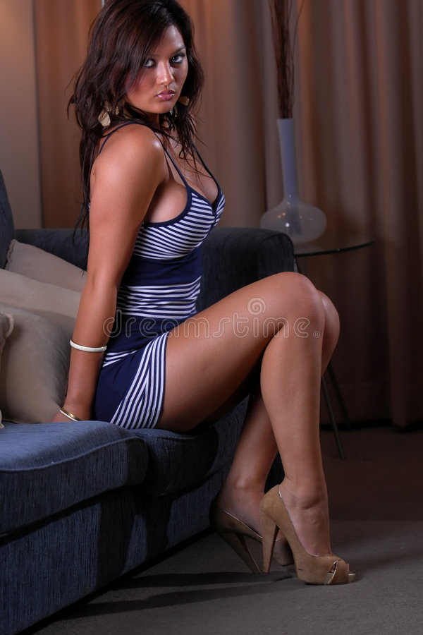 Asian girl. Posing in tight dress stock photo