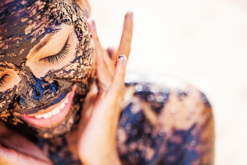 Asian girl applying chocolate face mask stock photo