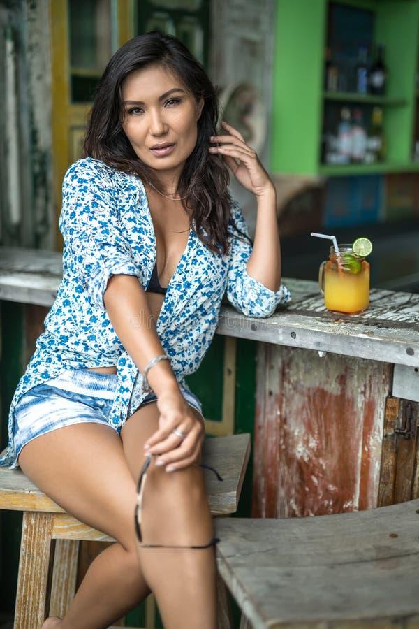 Asian girl in bar stock photography