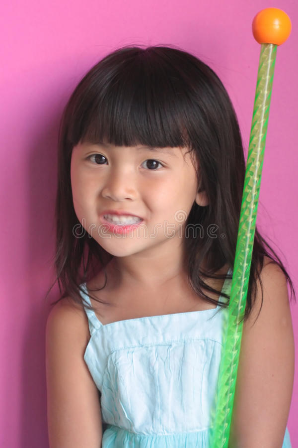 Asian girl with baton royalty free stock image
