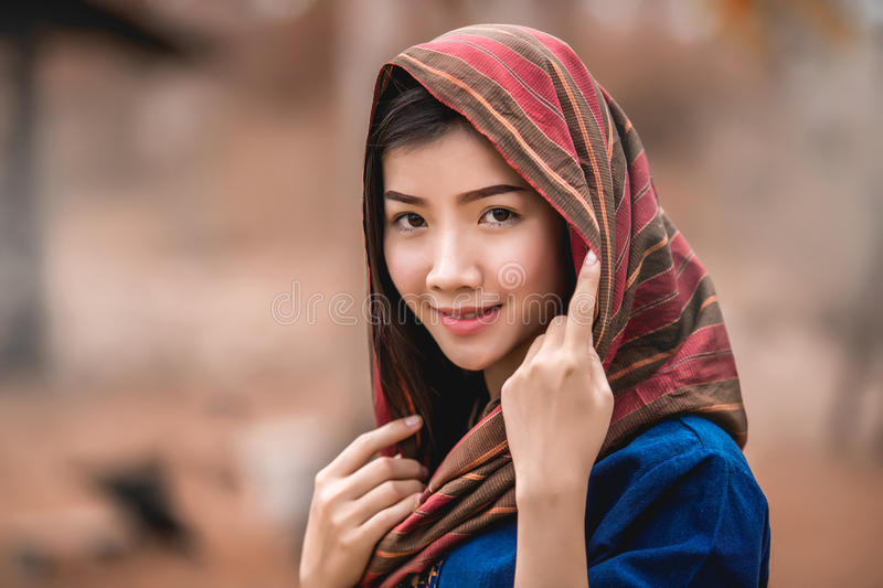 Asian girl beauty woman face portrait warmly clothed in winter h. Olding a scarf outdoors stock photos