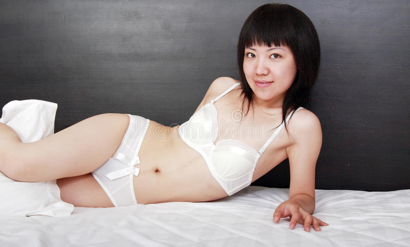 Download Asian girl on the bed. stock photo. Image of black, computer - 9813842