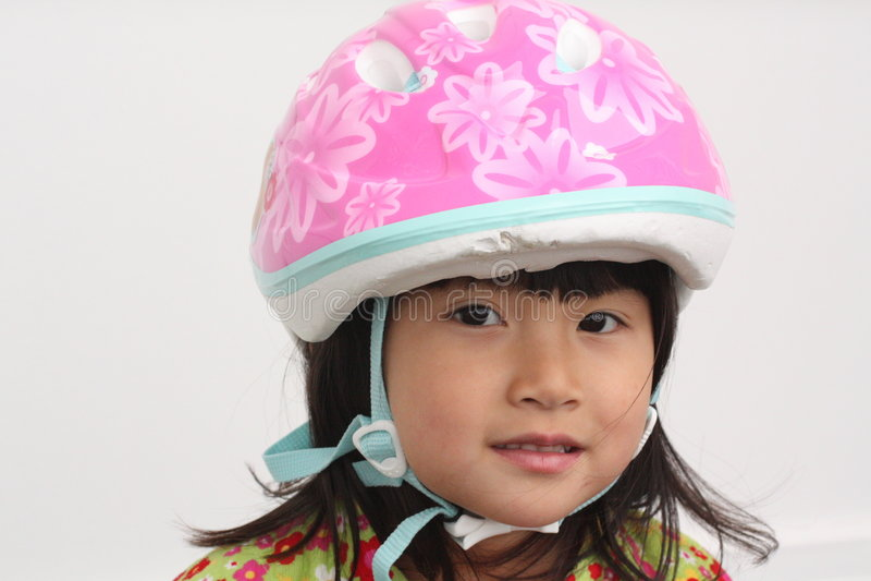 Asian Girl with Bike Helmet stock images