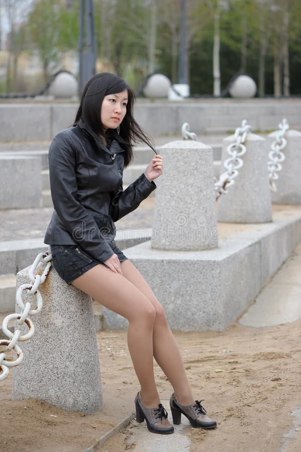 Asian girl in black jacket stock images