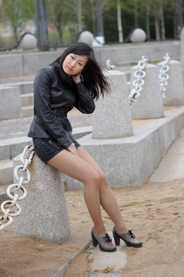 Asian girl in black jacket royalty free stock photo