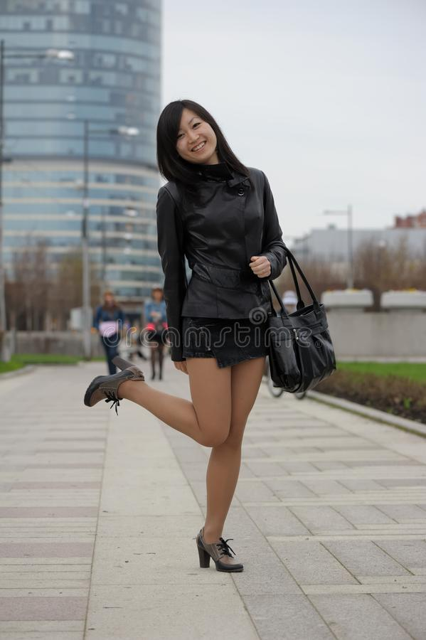 Asian girl in black jacket royalty free stock image