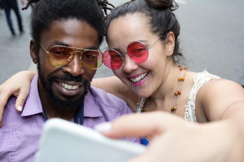 Asian girl and black man dating and having fun in the street. Multiethnic brazilian couple stock photo