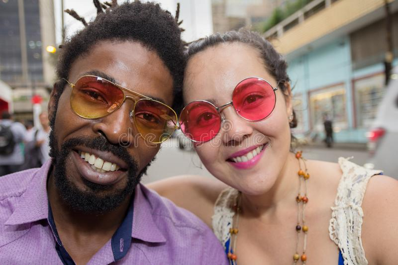 Asian girl and black man dating and having fun in the street. Multiethnic brazilian couple. Japanese women and black men dating and having fun in the street stock photography