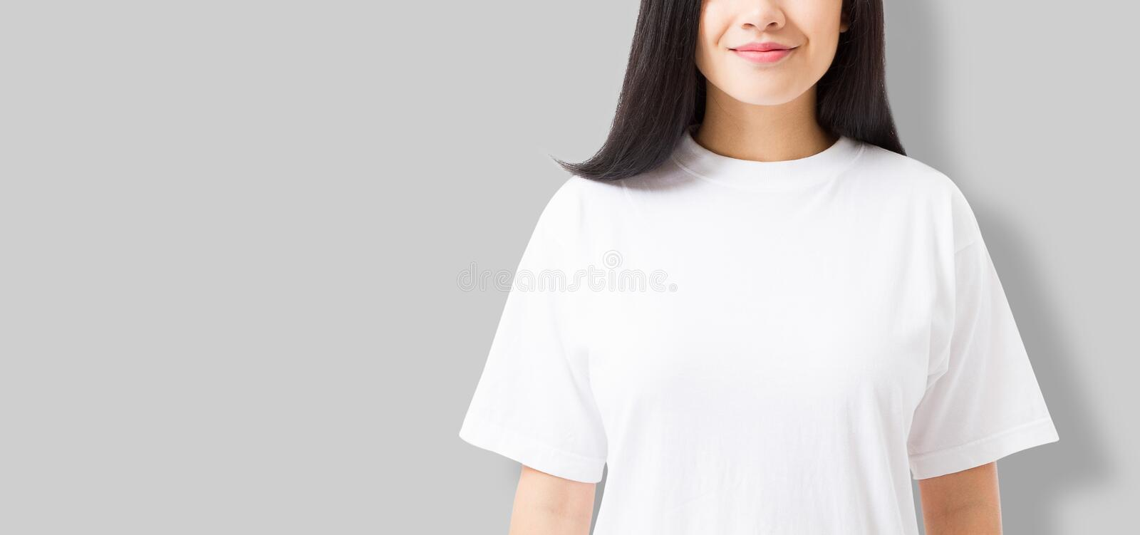 Asian girl in blank template t shirt on gray background. Young woman in tshirt copy space and mock up for advertising. stock image