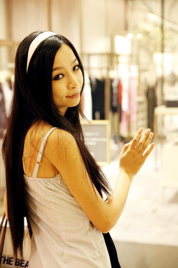 Asian Girl In A Boutique. Stock Photos