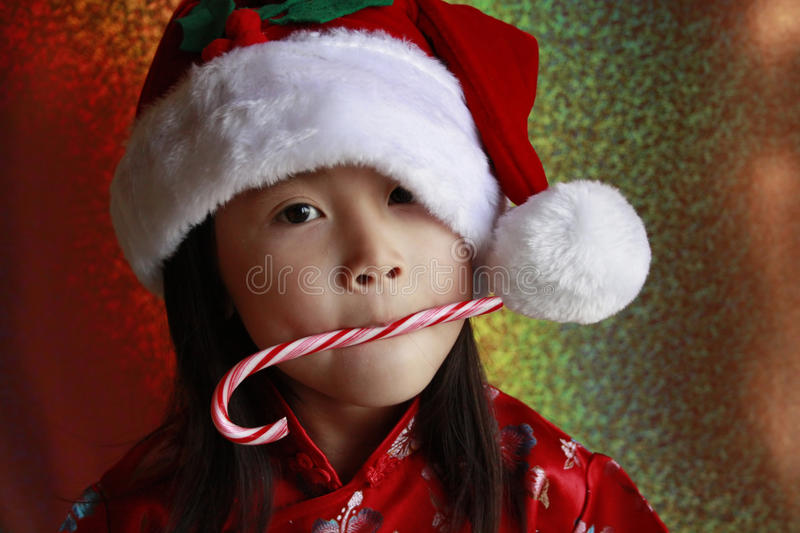 Asian Girl with candy cane stock images