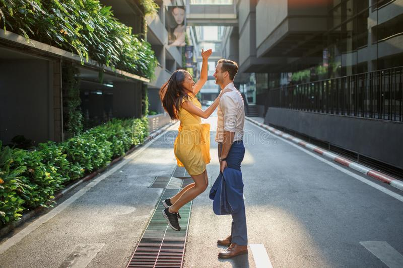 Asian girl and caucasian man together on the street stock photo