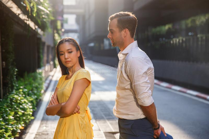 Asian girl and caucasian man together on the street royalty free stock photos
