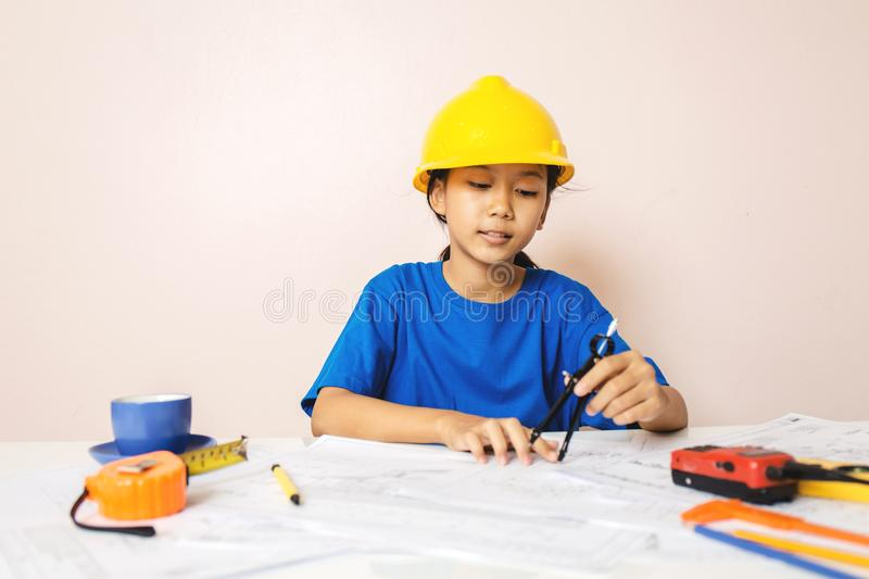 Asian girl child playing as an engineer the building royalty free stock photos