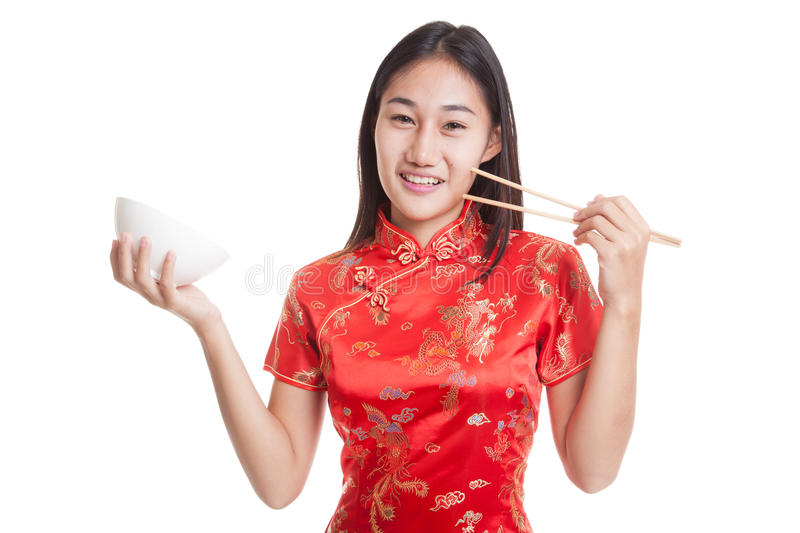 Asian girl in chinese cheongsam dress with chopsticks. Asian girl in chinese cheongsam dress with chopsticks isolated on white background stock photos