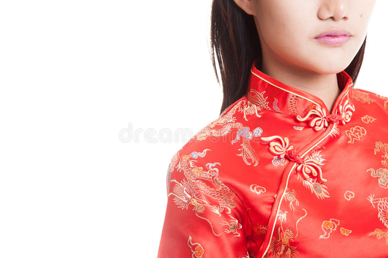 Asian girl in chinese cheongsam dress. Close up of Asian girl in chinese cheongsam dress isolated on white background stock image