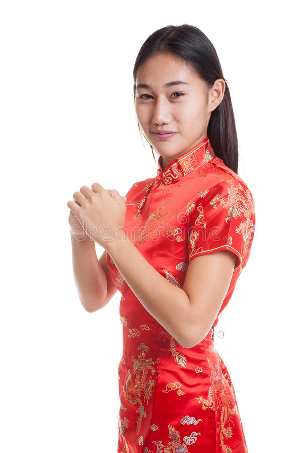 Asian girl in chinese cheongsam dress with gesture of congratulation. Asian girl in chinese cheongsam dress with gesture of congratulation isolated on white stock photos