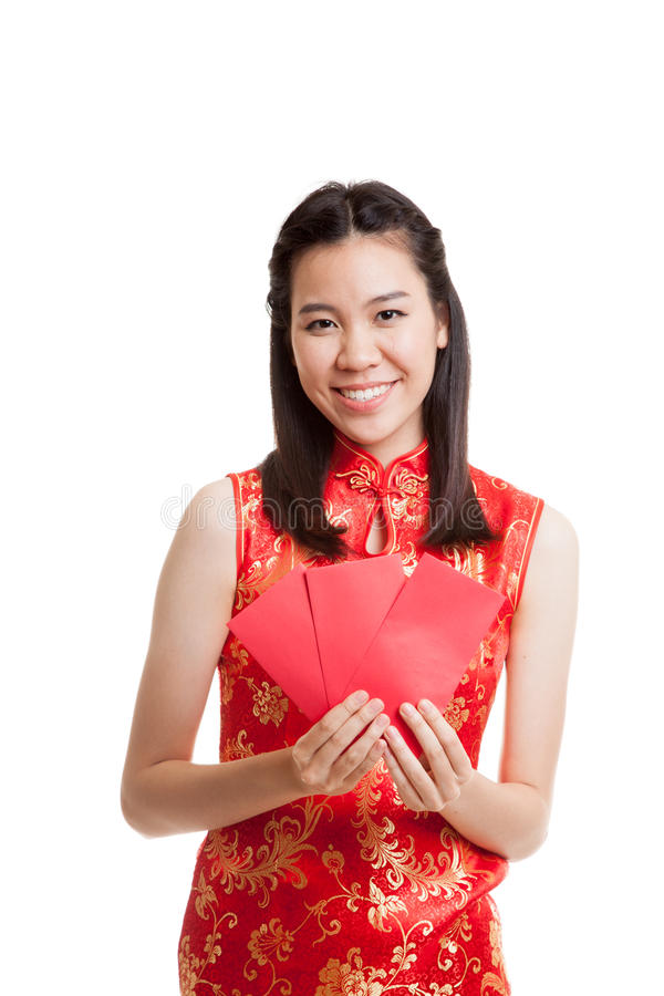 Asian girl in chinese cheongsam dress with red envelope. stock images