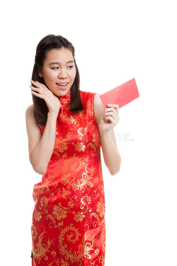 Asian girl in chinese cheongsam dress with red envelope. royalty free stock photo