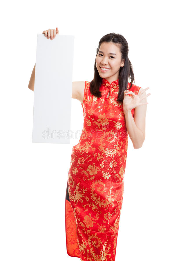 Asian girl in chinese cheongsam dress show OK with red blank si stock photo