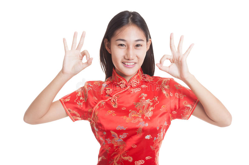 Asian girl in chinese cheongsam dress show OK sign. Asian girl in chinese cheongsam dress show OK sign isolated on white background stock image