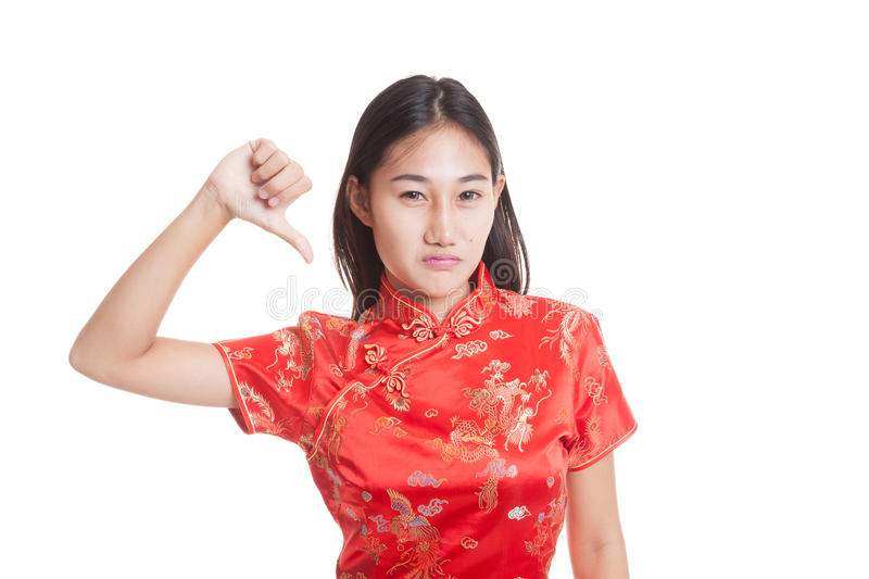 Asian girl in chinese cheongsam dress thumbs down. Asian girl in chinese cheongsam dress thumbs down isolated on white background royalty free stock photography