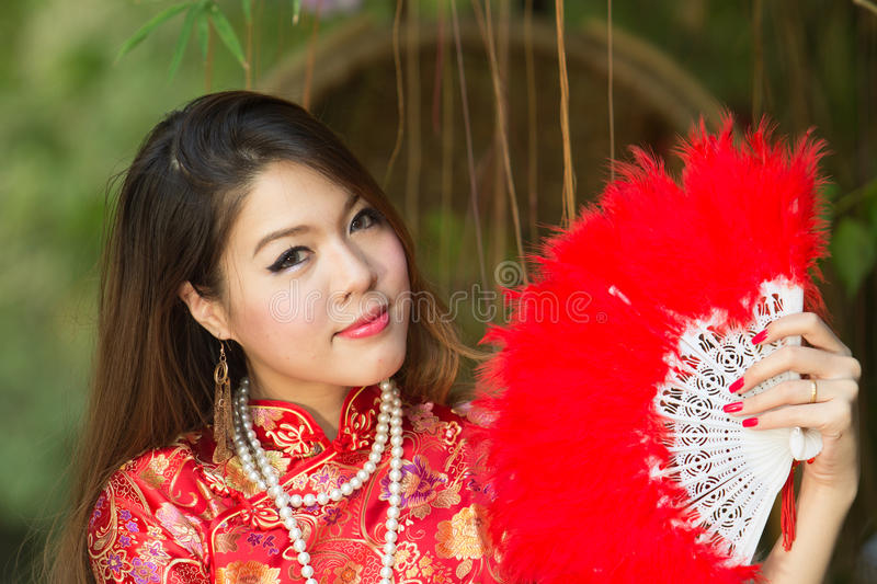 Asian girl with Chinese traditional dress stock photo