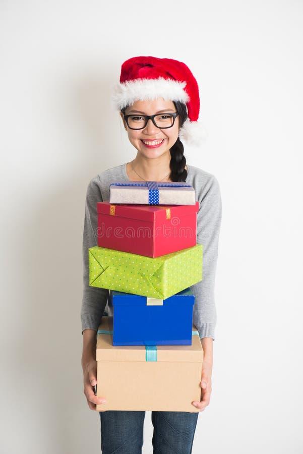 Asian girl with christmas gift stock photo