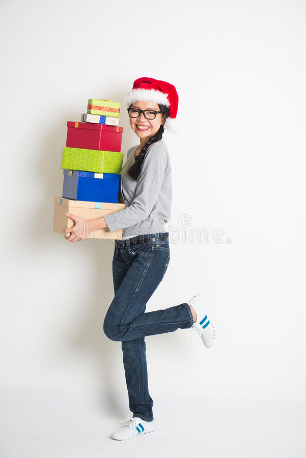 Asian girl with christmas gift royalty free stock photos