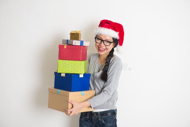 Asian girl with christmas gift stock photos
