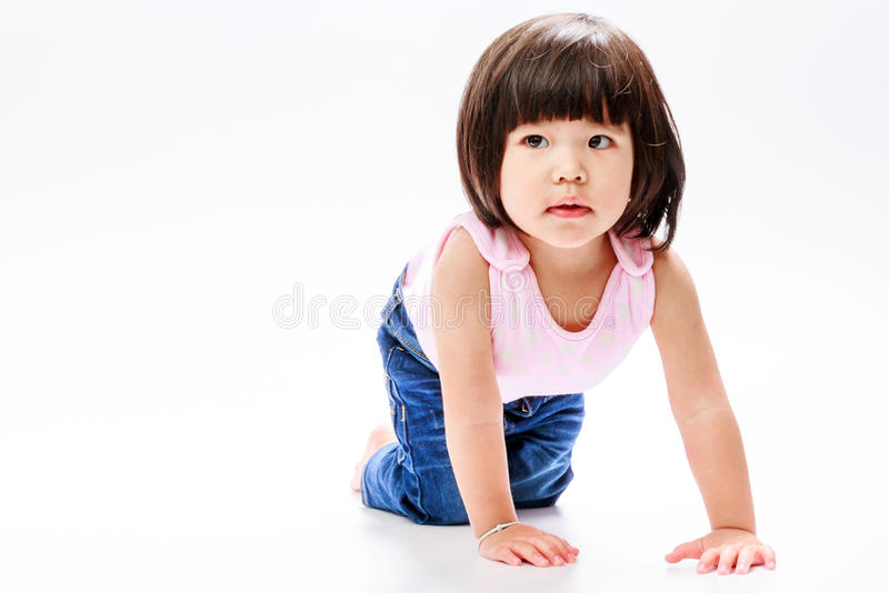 Asian girl crawl and looking in left royalty free stock images