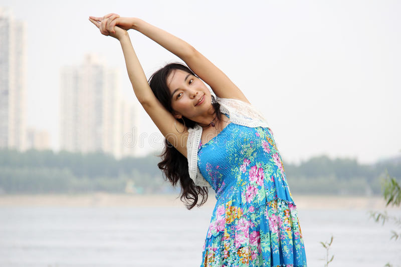 Download Asian girl do yoga stock image. Image of dress, people - 25450035