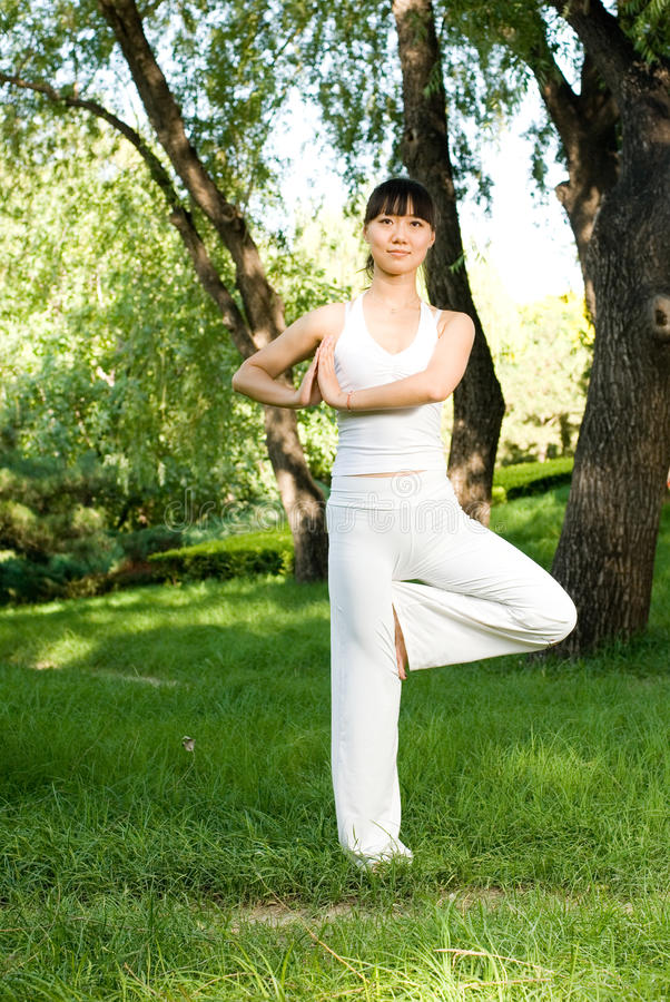 A asian girl doing yoga stock images