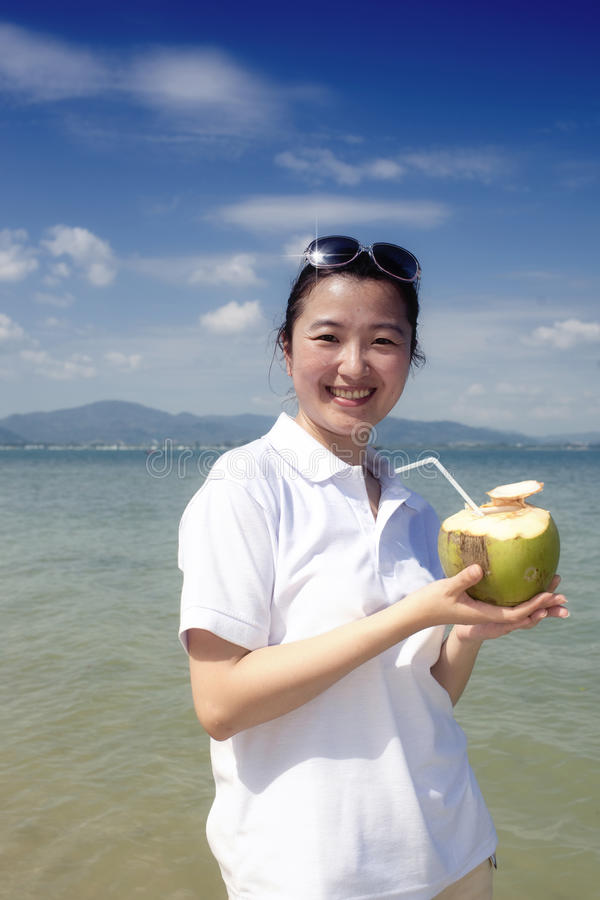 Download Asian Girl Drinking Coconut On The Beach Stock Image - Image: 22627401