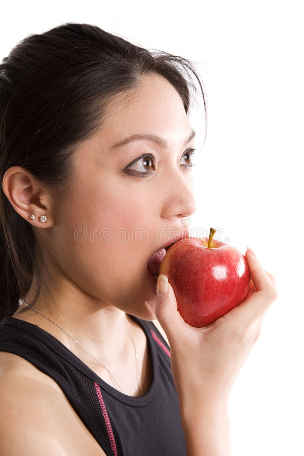 Asian girl eating an apple royalty free stock images