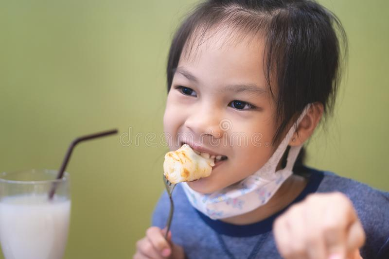 Asian girl eating in chinese restuarant stock image